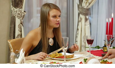 Young woman dinner in a restaurant