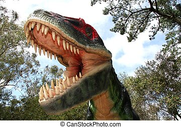 Scary dinosaur with it's mouth wide open showing enormous teeth