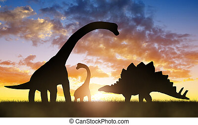 Dinosaurs in the sunset - Silhouette of dinosaurs in the...