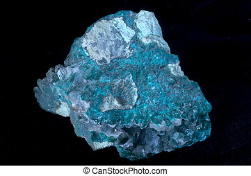 dioptase crystal stone in a black isolated background