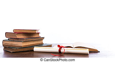 Diploma with old book isolated on a white background. -...