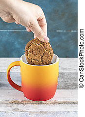 Dipping a cookie into tea