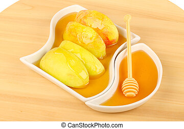 Dipping apples in honey
