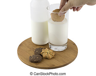 Dipping cookie in glass of milk
