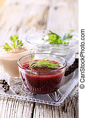 Dipping sauces - Selection of three dipping sauces on a tray