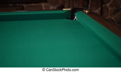 Direct hit into the pocket in a corner of a green billiards table