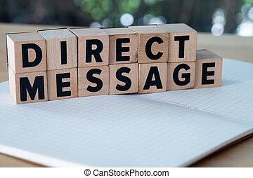 Direct Message word written on wood block.