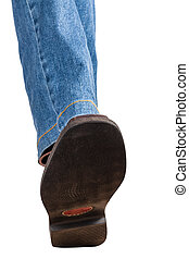 direct view of male left leg in jeans and brown shoe takes a step isolated on white background