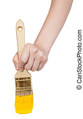 direct view of painter hand with yellow paintbrush