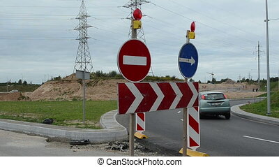 direction road sign cars