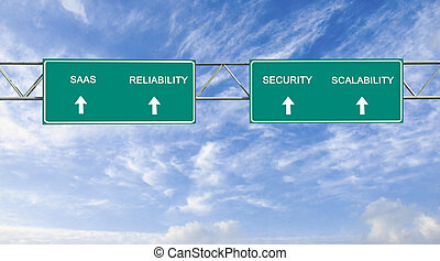 Direction road sign with words SAAS, scalability; ...
