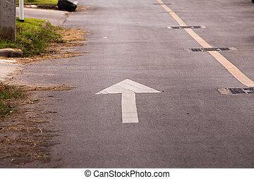 Directional arrow pointing forward street.