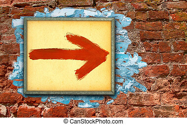 directional sign against old painted brick wall dating ...