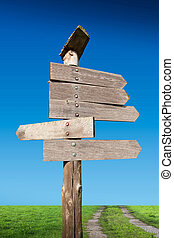 directional wooden arrows in nature background