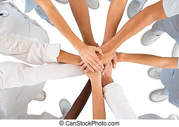Directly above shot of medical team standing hands against white background