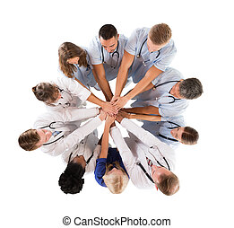 Directly Above Shot Of Multiethnic Medical Team Stacking...
