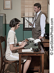 Director and secretary working together in the office -...