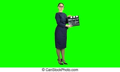 Director with clapper board is holding a movie in the hands...