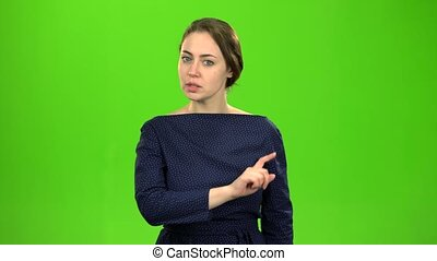 Director woman shows a stop to her subordinates. Green...