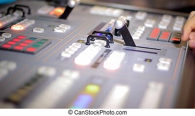 Director's hand move tv broadcasting mixer