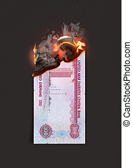 Dirham Note Burning - A concept image showing a half burnt ...