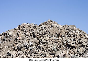 A pile of dirt and busted-up rubble at a construction site.