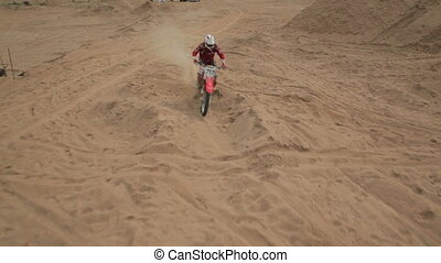 Dirt bike off roading on sand dune,aerial shot