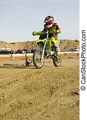 Dirt bike racer on track racing