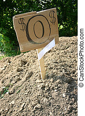 Dirt Cheap! - a pile of dirt beside a city sidewalk