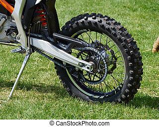 Dirt motocross bike on the grass