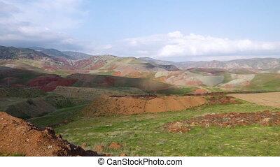 Dirt Mounds and Mountainous Hills 2 - Handheld, panning,...