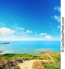 dirt path to the sea in Sardinia,