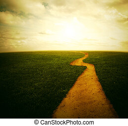 Dirt pathway to the sunset - Beautiful sunset in a grassy...