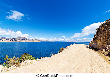 Dirt Road and Lake Titicaca