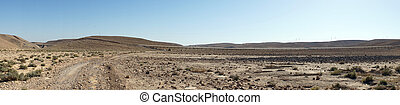 Dirt road and long conveyor in Israel