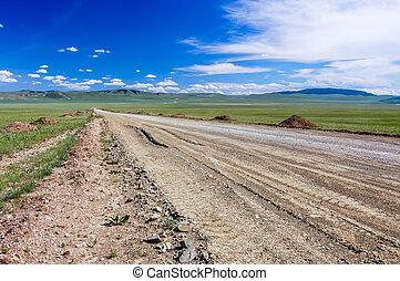 Dirt road & blue sky, Mongolian steppe