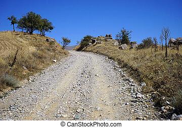Dirt road - Details of roman aqueduct near dirt road in ...