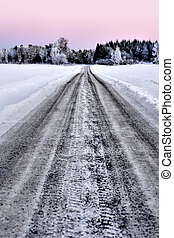 Dirt road in winter - rural dirt road on cold winter evening...