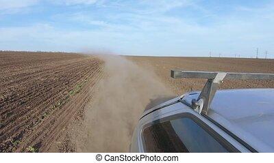 Dirt road plowed field