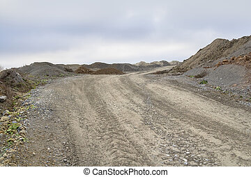 dirt road and spoil heaps at a quarry