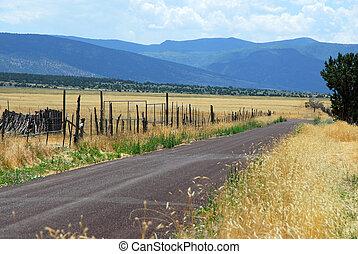 Dirt road through a rural valley