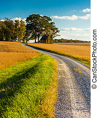 Dirt road through farm fields in rural York County,...