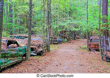 Dirt Road Through Junkyard