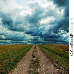 Dirt Road Through the Prairie in Storm - Dirt road through...