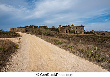 dirt road to an abandoned house