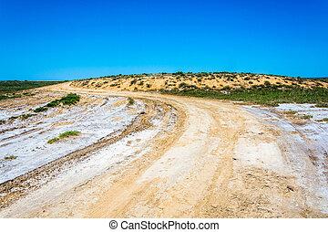 Dirt road to the salt lake Elton.