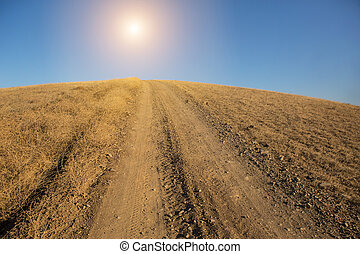 road to the sun on top of a hill