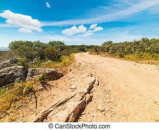 dirt road under a blue sky in Sardinia