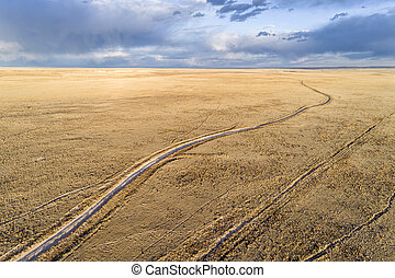 Dirt road winding through prairie in northern Colorado