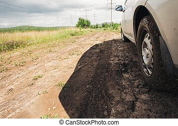 dirt under the wheel of car